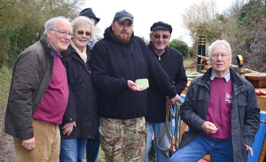 Members of the Wendover Arm Trust and The Friends of Raymond after the trip with Nick Scarcliffe holding the Wendover Arm plaque